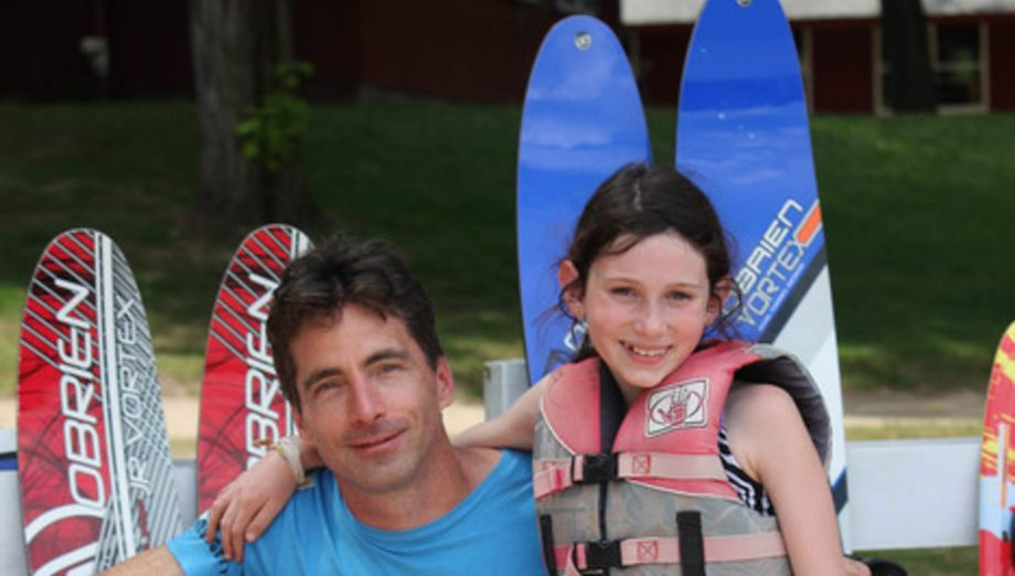 Father and daughter by waterskis at Family Camp